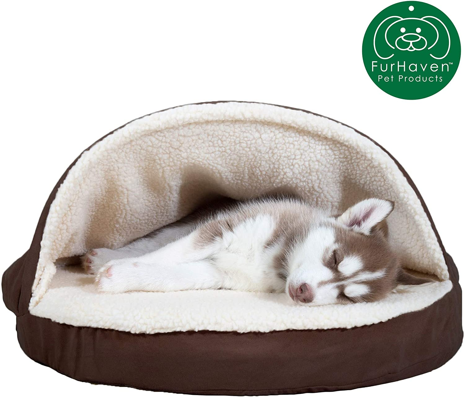 husky puppy lying in a cave style dog bed