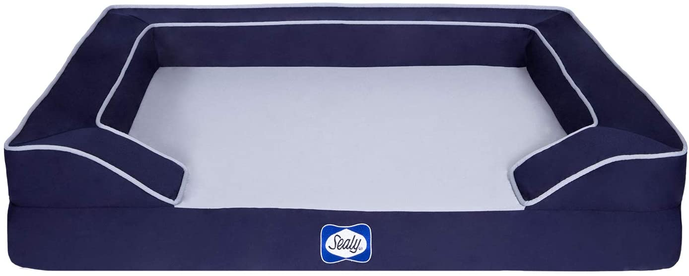 Blue dog bed with bolsters and white cooling mattress to help your dog stay cool